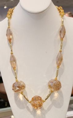 Long necklace of large champagne gold crystals