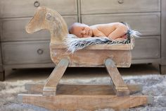 Sweet lil' guy sleeping in his RH Baby and Child rocking horse #rhbabyandchild #fallinlove