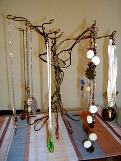 Upcycled Wire Coat Hanger Jewelry Tree Stand. $15.00, via Etsy.