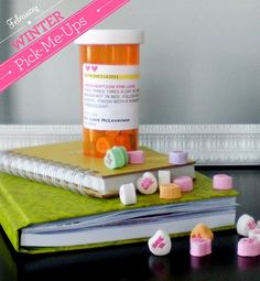 a prescription bottle filled with conversation hearts for the lovesick