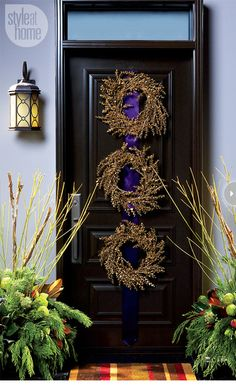 14 Triple the fun There's no rule saying 'only one wreath per door'. Elaborate on your outdoor holiday decorating by creating a front door f... holiday ideas, black doors, christmas holidays, christma decor, front doors, holiday decorating, tripl wreath, porch, christmas door
