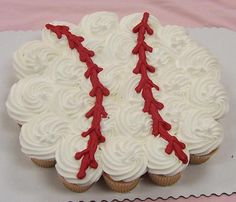 Pull-apart cupcake cakes shaped like a baseball.