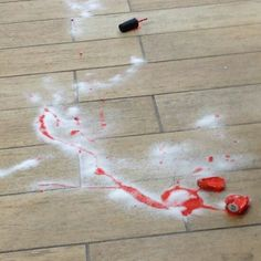 Pour sugar on spilt nail polish. It will clump up and you can wipe it away!!