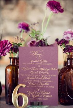 Purple Floral Centerpieces with Menu and Table Number