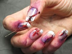 A great zombie nail for holloween - these make me cringe just looking at them! Especially that needle - yikes!