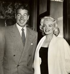 Marilyn Monroe and Joe Dimaggio beaming