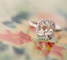 a peach champagne sapphire halo-ed in tiny diamonds. i've never seen a ring i loved so much.
