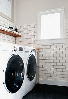 Use subway tiles and maximize storage space for a complete laundry room makeover!