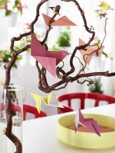 MÅLA colored paper, folded into origami birds hanging from branches, make easy and inexpensive, but beautiful, DIY decorations.