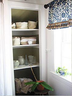 master bath - open linen closet for built in shelving
