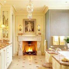 Fireplace, sconces, bell jar lanterns in the bathroom - Suzanne Tucker