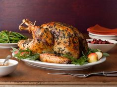 A good turkey starts well before Thanksgiving day is upon us. Begin preparing this Brined Herb-Crusted Turkey With Apple Cider Gravy three days ahead of Thanksgiving. #FNThanksgiving
