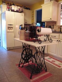 Here's what you could use those old Singer Sewing Machines for - a kitchen island.  I'd leave the top bare and take out the rug below it. table bases, little houses, sewing tables, antique sewing machines, small kitchens, sew machin, kitchen islands, table designs, old sewing machines