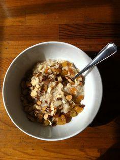 Simple healthy breakfast: Steel cut oats, almonds, golden raisins.
