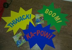 Inflatable boxing gloves and comic book signs for party games