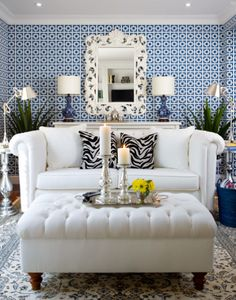 Not Your Grandma's Wallpaper.  White and navy living room with gorgeous mirror for centerpiece and animal print pillows