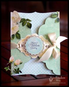 Die cut shape gatefold card with belly band made of ribbon attached tot die cut card stock.