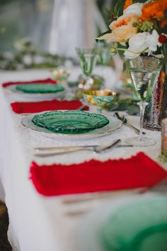 red and green reception, photo by Love Me Do Photography http://ruffledblog.com/skaneateles-lake-wedding #weddingreception #tablescape