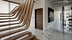 Waves of wood form the staircase inside this Mumbai apartment