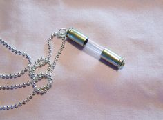 Recycled bullet shell casings cap a glass vial ready to fill with tiny treasures.