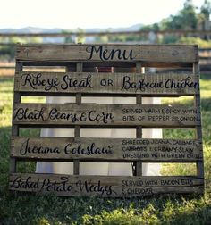 Dinner menu on a wood pallet~SO COOL! I'm loving the more laid back fun look!