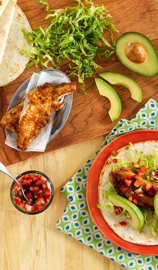These Fast Fish Tacos with Strawberry-Tomato Salsa made with seasoned tilapia are sure to add a spring touch to your dinner table. The salsa could also be made with mango or peaches! #recipes #light #fresh #healthy