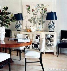 Domino Magazine - dining rooms - mirrored console, mirrored buffets, white mirrored buffets, mirrored sideboard,  Eclectic dining vignette. ...