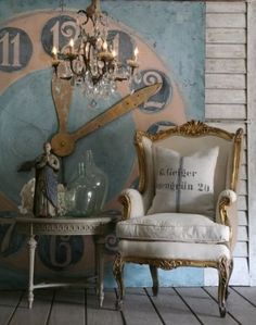 Chair and the painted wall.  I love the painted clock on the wall!  :)