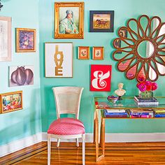 Sea Glass Green Walls with an Eclectic Art Wall Display // GoodHousekeeping.com - #BoldAndBright #ArtDisplay #WallGrouping #Turquoise