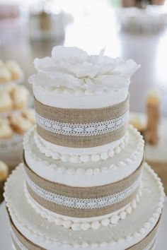 Burlap and White Wedding Cake. Love the burlap, less tiers, and a splash of color!