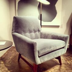 Jewel-shaped chair w thin lines, button tufting and light wood legs for Fall #hpmkt (via @Apartment Therapy)