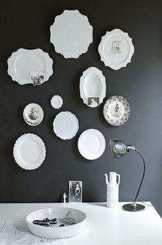 white plates/dark wall