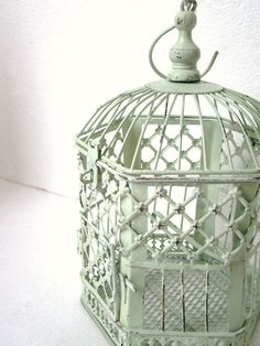 Incredible upcycled and distressed shabby chic bird cage & candle holder or home decor. Perfect shade of green for our wedding!