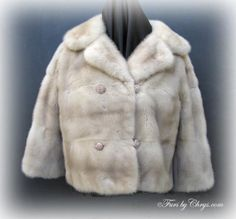 Vintage Azurene Mink Short Jacket #AM703; $600.00; Excellent Condition; Size range: 6 - 10 Misses, Petite or Tall. This is a stunning vintage genuine natural azurene mink fur short jacket. It has a Marshall Field and Company label and features a large notched collar, gorgeous amber-colored rhinestone studded buttons and very stylish half-sleeves. The pelts are sewn on the horizontal adding to the drama.  This is that extra-special bombshell mink jacket that will knock their socks off! Luxury! fur short, short jacket, vintag fur, fur fashion, mink jacket