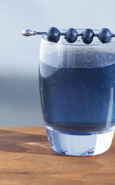 Midnight Blue Margarita ~ 1.5 oz tequila blanco, .5 oz blue curacao, .75 oz blueberry syrup*, .5 oz meyer lemon juice