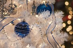 White Christmas tree with beautiful deep blue ornaments