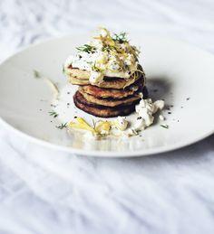 Potato pancakes with feta, dill and lemon toppings.
