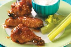 Apricot Chicken Wings Recipe:  For those who prefer their wings on the mild side, this chicken wing recipe from Taste of Home seasons them with apricot preserves and cider vinegar to offset the heat from the hot pepper sauce and chile powder.