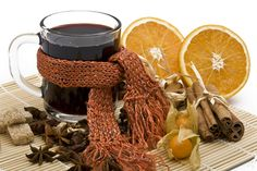 mulled wine for wedding. cute scarf around mug. cinnamon + orange slices. open goosberries are a cute touch + star anise