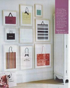 """Such a cute  inexpensive decorating idea--designer """"shopping bags"""" framed and clustered together."""