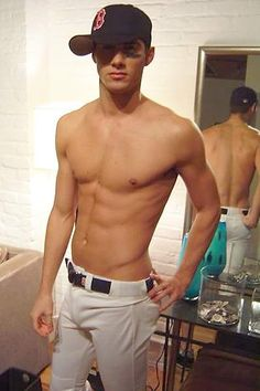 Love baseball players! And this one is wearing a red sox cap..... Win!!!