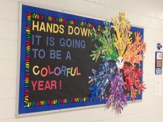 Ms. Art Teacher: My beginning of the year bulletin board! I had the kids collage each hand using the color assigned to them to make a color wheel.