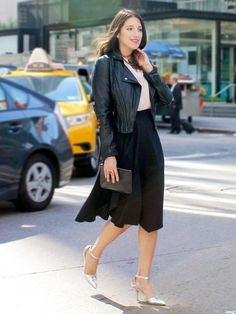 Lipstick.com executive online editor Lindsey Unterberger in a leather jacket, midi skirt, and heels