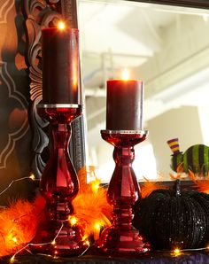 Instant Halloween vibe: A feather boa, glimmer strings and dark candles