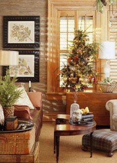 A tabletop tree and basket of presents await in the den.