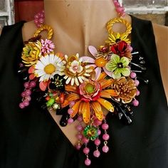 Wendy Baker Designs,  her necklaces are spectacular.  Combining vintage and new components to make these wonderful bold necklaces.