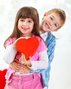 """Valentine's Day traditions to start with your children.  In our home we have a special """"I Love you dinner"""" where both parents and kids sit for a fun time and sharing kind words."""