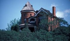Redstone Castle on Iron Mountain near Manitou Springs, Colorado ~ Over the years, it became known as Redstone Castle due to its magnificent stature on the hillside & the fact that it is made of red stone that comes from the local quarries.  The house may have been vacant for a good portion of it's existence, but many believe it to be haunted by spirits from the past.