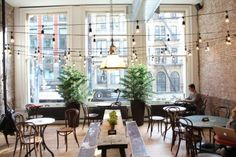 interior, shop, hanging lights, string lights, cafe, exposed brick, restaurant, place, long tables