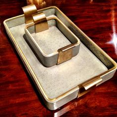 These gorgeous brushed brass and blue ostrich embossed leather trays frim Theodore Alexander exude timeless chic 229 West Russell Avenue #hpmkt